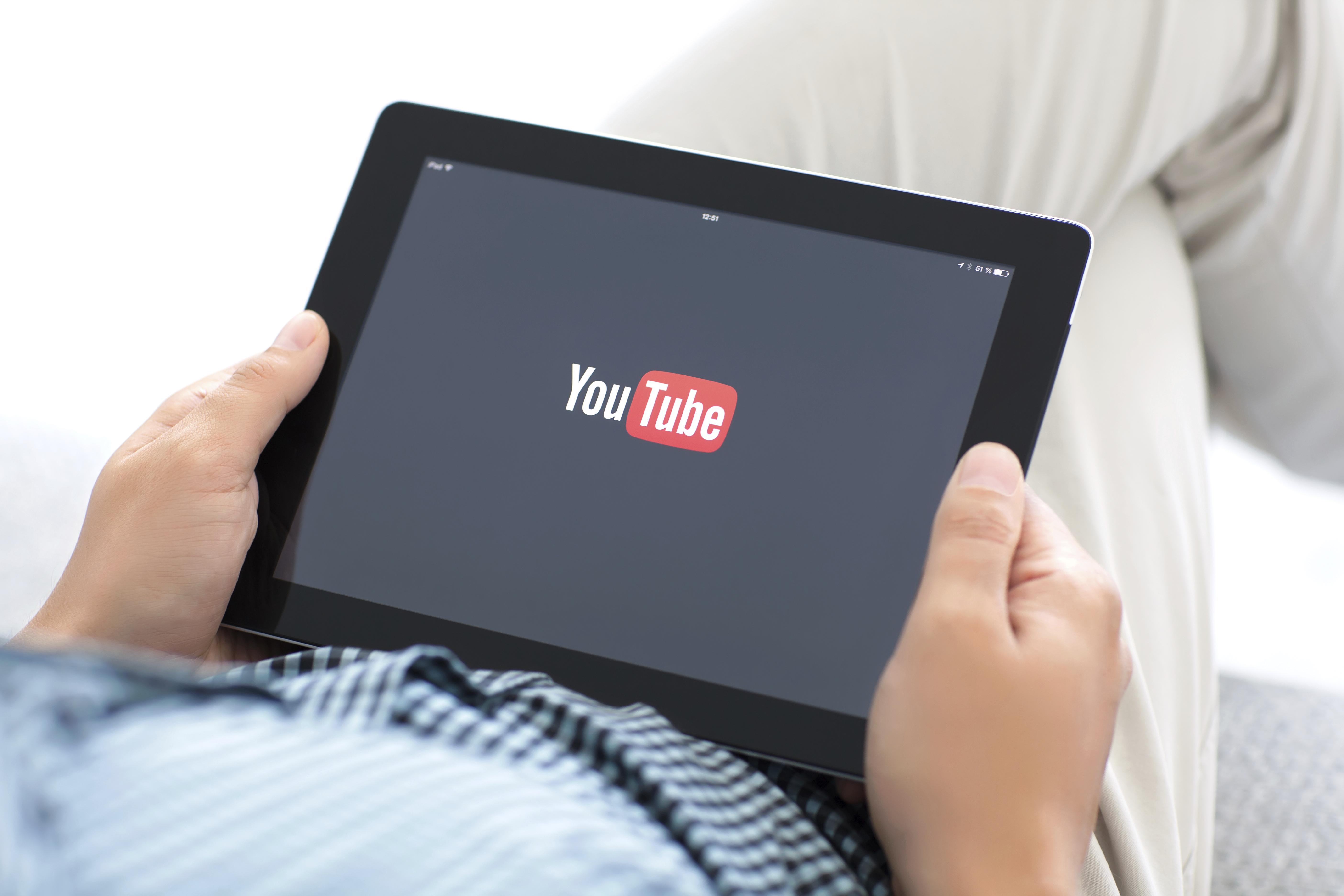 man watching youtube on iPad